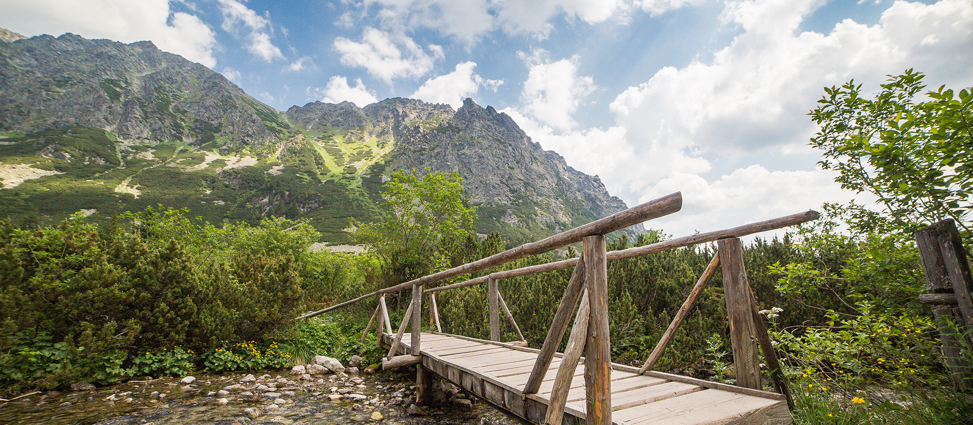 wooden-bridge-over-river-in-mountains